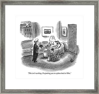 A Woman Is Seen Speaking With A Man Who Is Seated Framed Print