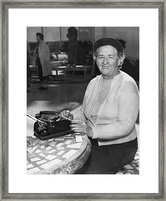 A Woman Journalist Typing Framed Print by Underwood Archives