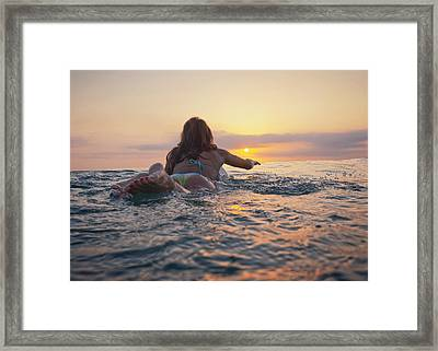 A Woman Laying On A Surfboard Watching Framed Print