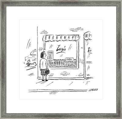A Woman Looks Into A Restaurant Window That Framed Print