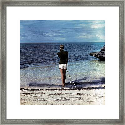A Woman On A Beach Framed Print