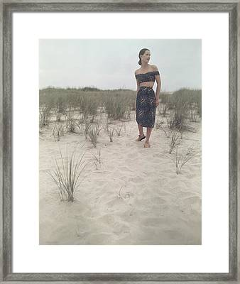 A Woman On A Beach Wearing An Off-the-shoulder Framed Print by Serge Balkin