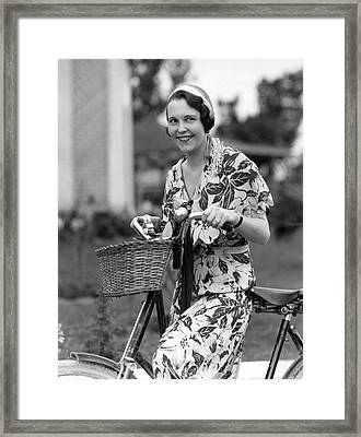 A Woman On A Bicycle Framed Print