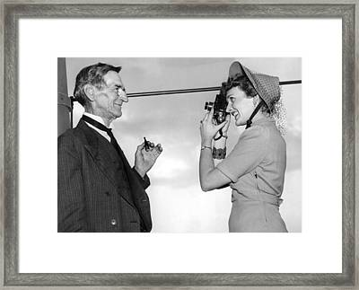 A Woman Photographs Her Father Framed Print