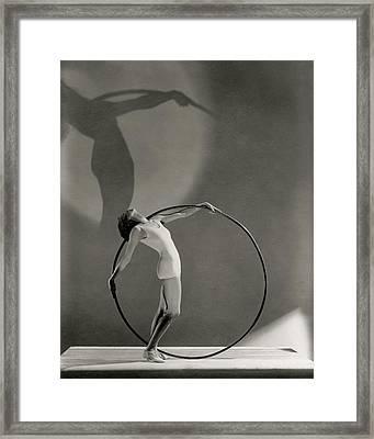 A Woman Posing With A Hula Hoop Framed Print by George Hoyningen-Huene