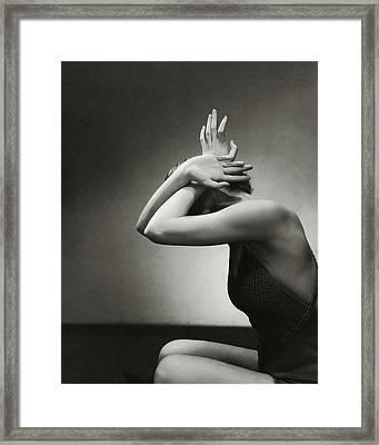A Woman Shielding Her Head Framed Print