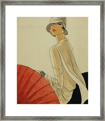 A Woman Sitting Wearing A White Jacket And Pearl Framed Print