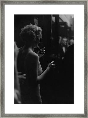 A Woman Smoking At The Music Box Framed Print by Remie Lohse