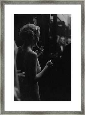 A Woman Smoking At The Music Box Framed Print