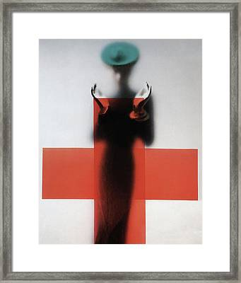A Woman Standing Behind A Red Cross On Frosted Framed Print by Erwin Blumenfeld