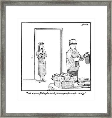 A Woman Stands In The Doorway Talking Framed Print