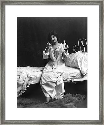 A Woman Taking Medicine Framed Print by Underwood Archives