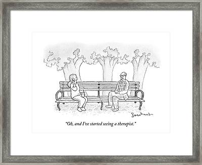 A Woman Talks On Her Cellphone While Sitting Framed Print