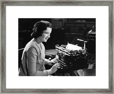 A Woman Typing Framed Print