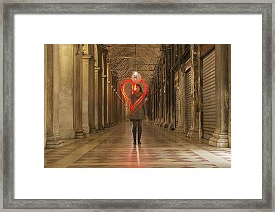 A Woman Walking In A Corridor Making Framed Print by Mats Silvan