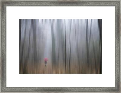 A Woman Walking With A Red Umbrella Framed Print