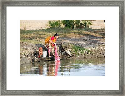 A Woman Washing Clothes Framed Print