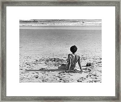 A Woman Wave Watching Framed Print