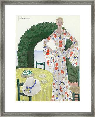 A Woman Wearing A Floral Dress Framed Print by Georges Lepape