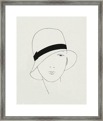 A Woman Wearing A Hat Framed Print