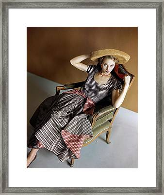 A Woman Wearing A Patterned Dress Sitting In An Framed Print