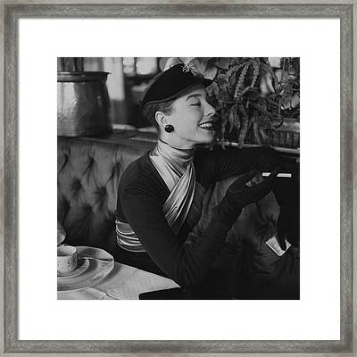 A Woman Wearing Dior Framed Print by Henry Clarke