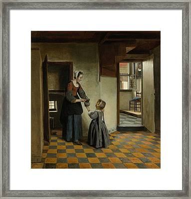 A Woman With A Child In A Basement Room Framed Print by Pieter de Hooch