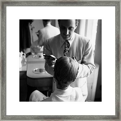 A Woman With A Hairdresser Framed Print