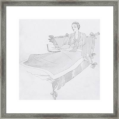 A Women Sitting In Bed With A Book Framed Print
