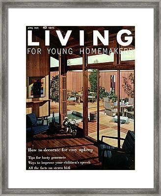 A Wood Paneled Living Room Framed Print by Ernest Silva