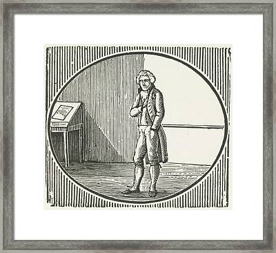 A Woodcut Of A Man Standing Framed Print by British Library
