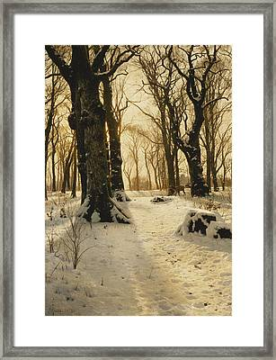 A Wooded Winter Landscape With Deer Framed Print