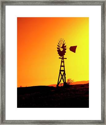 A Wooden Windmill Silhouetted Framed Print by John Alves