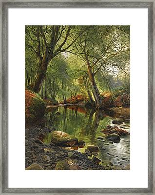 A Woodland Stream Framed Print by Peder Mork Monsted
