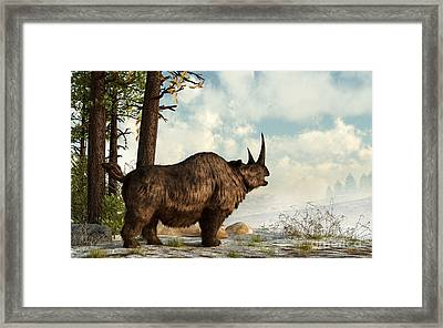 A Woolly Rhinoceros Trudges Framed Print
