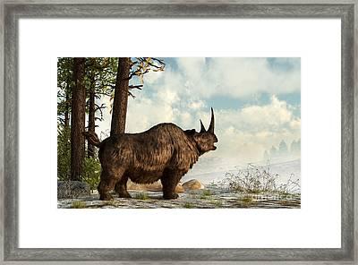 A Woolly Rhinoceros Trudges Framed Print by Daniel Eskridge