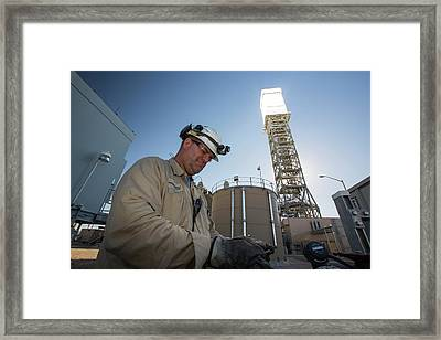 A Worker At The Ivanpah Solar Framed Print