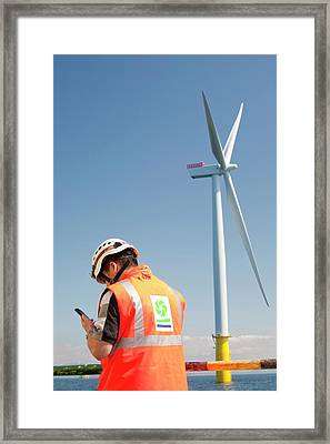 A Worker On A Jack Up Barge Framed Print by Ashley Cooper