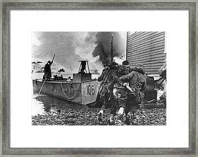 A Wounded British Commando Is Being Evacuated After A Raid On Ge Framed Print by Underwood Archives