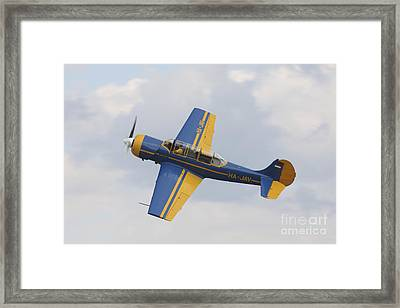 A Yakolev Yak-52 Plane Flying Framed Print