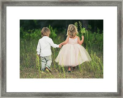 A Young Boy And Young Girl Holding Framed Print by Ben Welsh