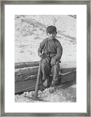 A Young Boy Digging Coal Framed Print by Stocktrek Images