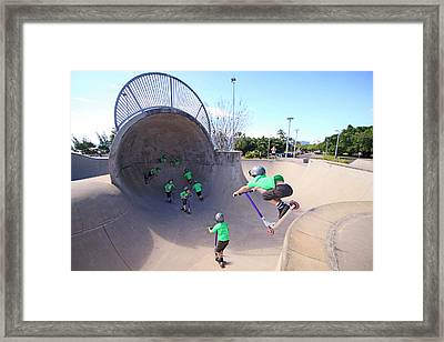 A Young Boy Rides His Scooter Framed Print