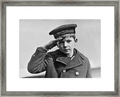 A Young Boy Saluting Framed Print