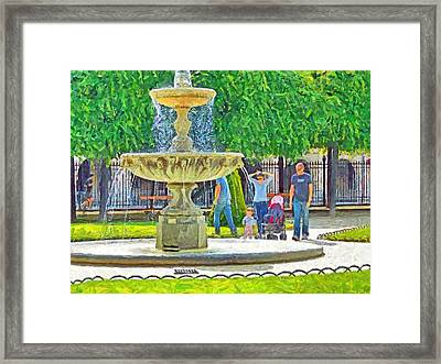 A Young Family At A Park In Paris Framed Print