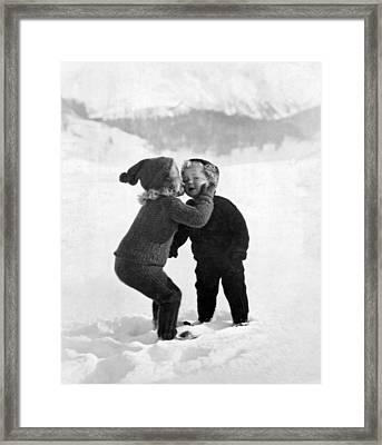 A Young Girl Gives Her Little Brother A Kiss On The Cheek In The Framed Print