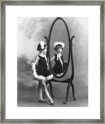 A Young Girl In A Mirror Framed Print by Underwood Archives