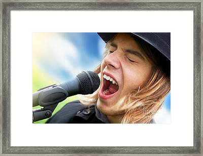 A Young Man Sings To A Microphone Framed Print by Michal Bednarek