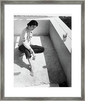 A Young Model Crouching On A Porch Framed Print by Horst P. Horst