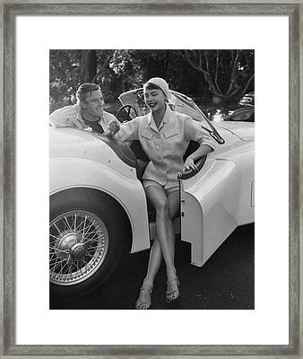 A Young Model Sitting In A Convertible Sports Car Framed Print by Karen Radkai